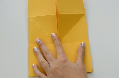 Fold the Corners Up to Form 4 Squares.