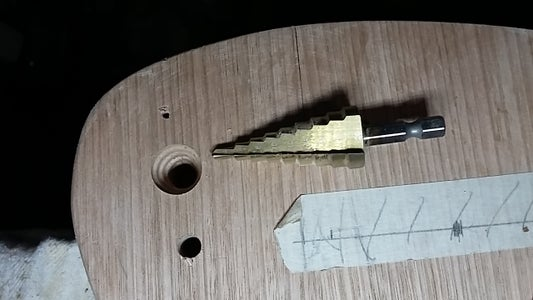Holes for the Volume and Tone Potentiometers.