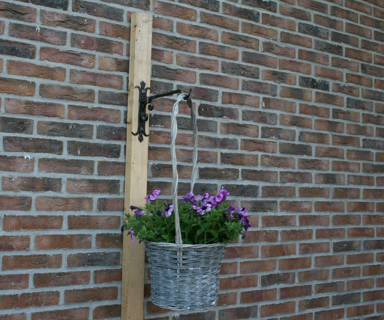 Forging a plant basket hanger of 3 railroad spikes