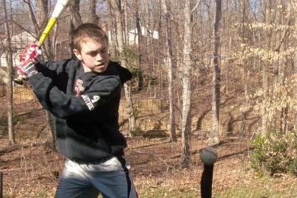 Hitting a Baseball Off a Tee