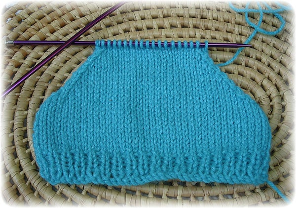 How to Decrease Neatly to Form the Shaping of  Shoulder Seams on Knitted Sleeves