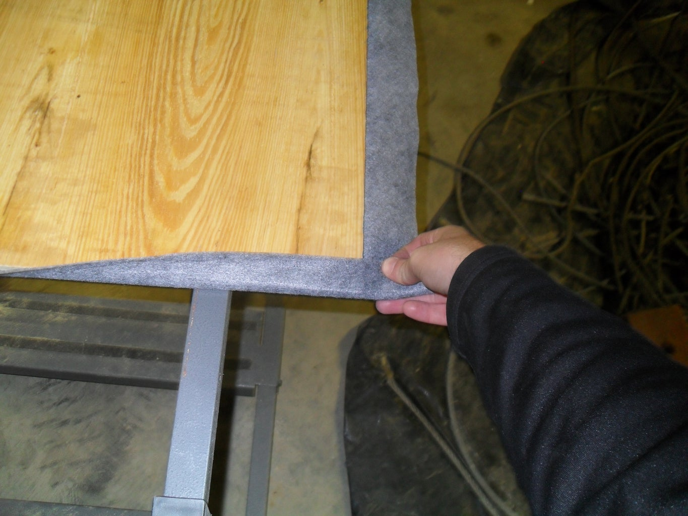 Gluing Down the Corners of the Felt