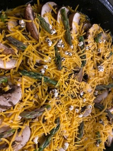 Arrange Mushrooms, Then the Rest of the Cheddar Cheese, Sprinkle With Goat Cheese Crumbles  and Asparagus Heads Like the Photo.
