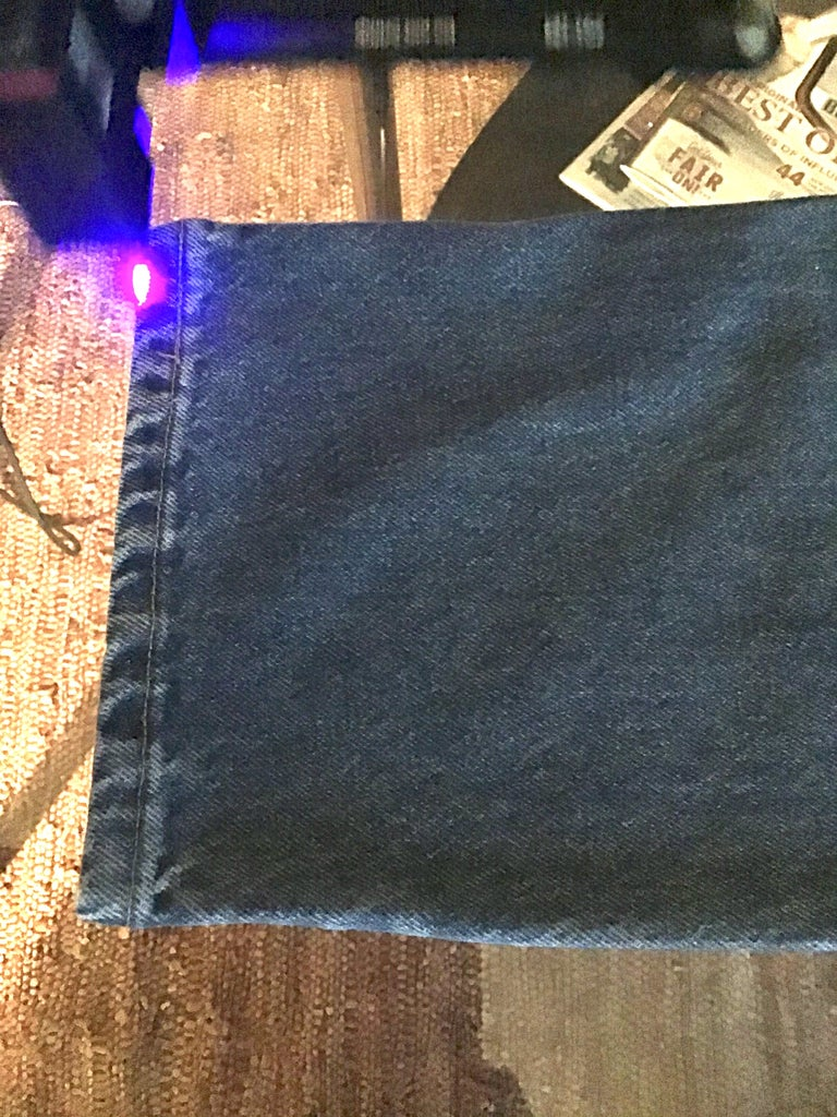 Lining Up the Laser the Denim Jeans.