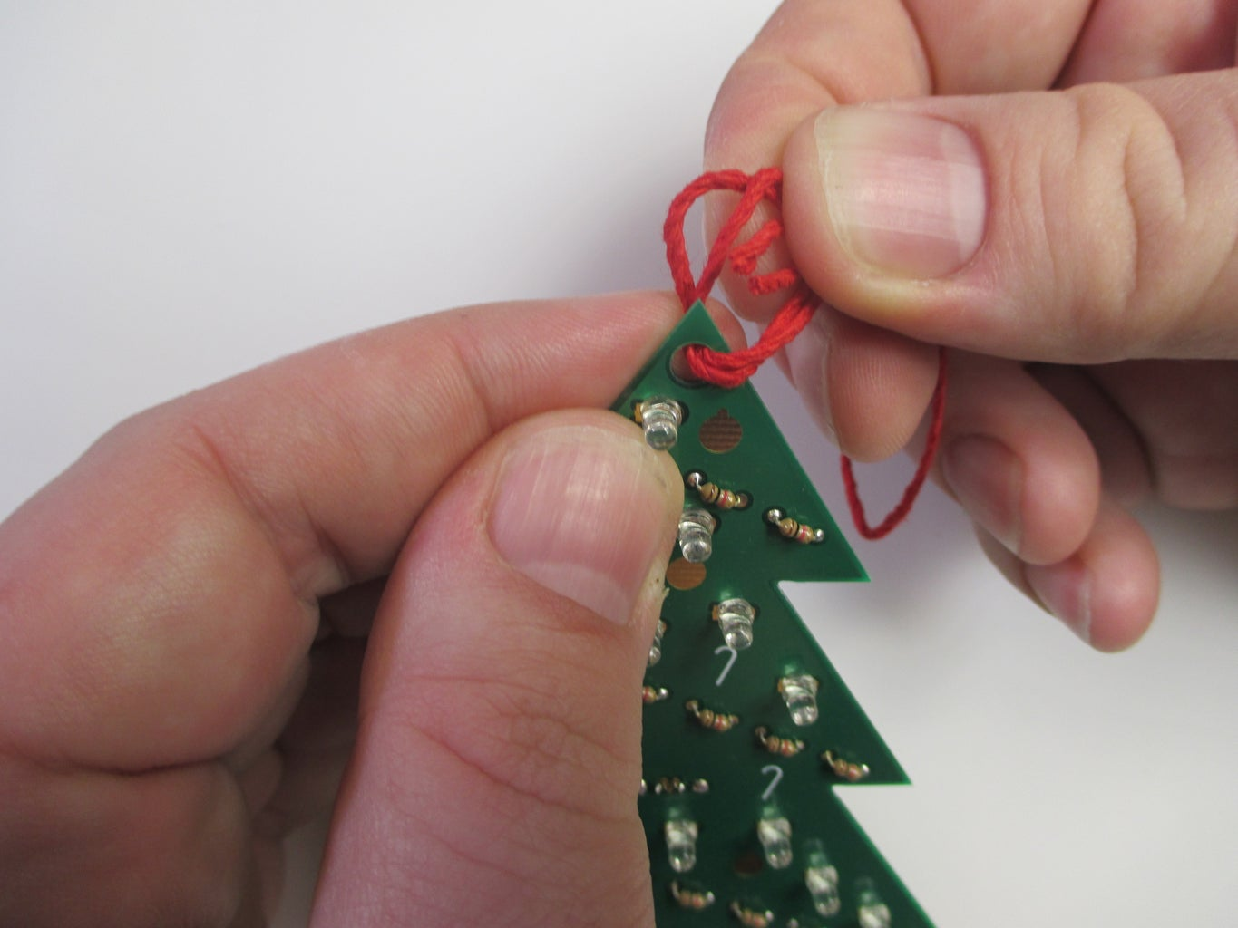 Tie the String Through the Hole in the Ornament