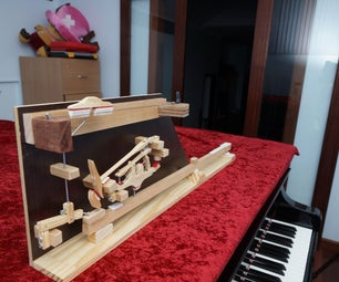 Hand Making a Grand Piano Action Model