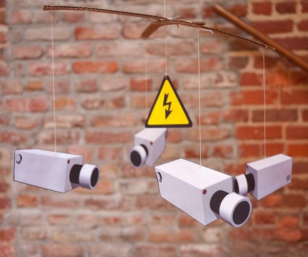 Banksy-style CCTV Mobile