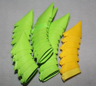 Putting It Together - the Tail (35 Green Triangles + 7 Yellow Triangles)