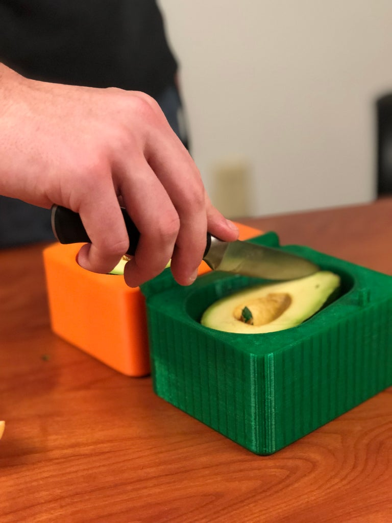 With 2 Halves Still Attached to Pins, Cut Avocado Into Slices Pressing Against Hard Surface
