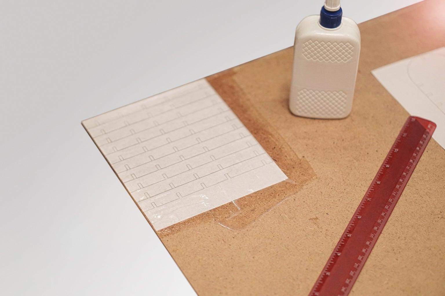 Apply Stencils to Hardboard