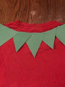 Cut Triangles Out of the Construction Paper; Overlap and Hot Glue Around the Neckline
