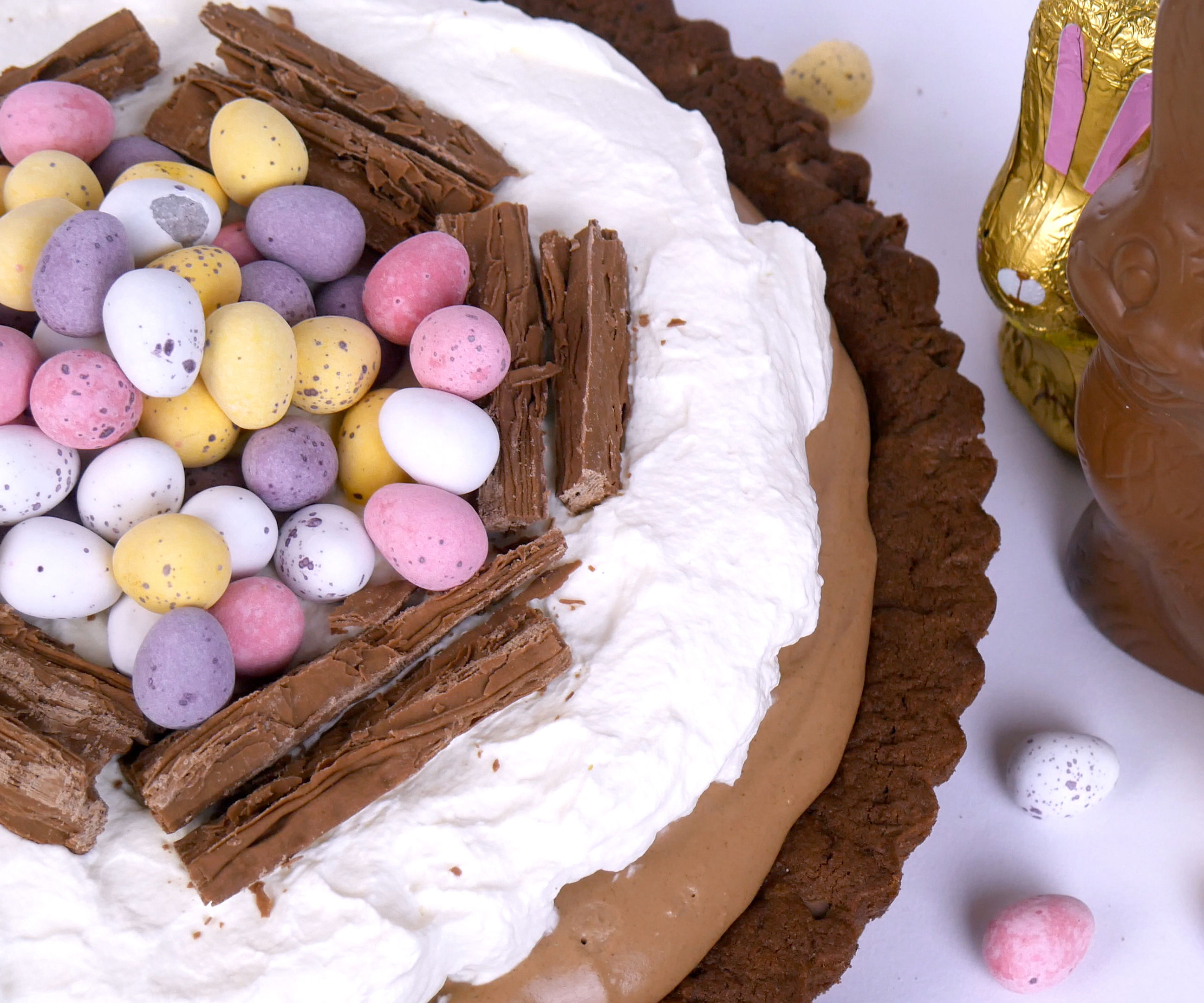 TRIPLE CHOCOLATE COOKIE EASTER CREAM TART WITH CADBURY EASTER EGGS
