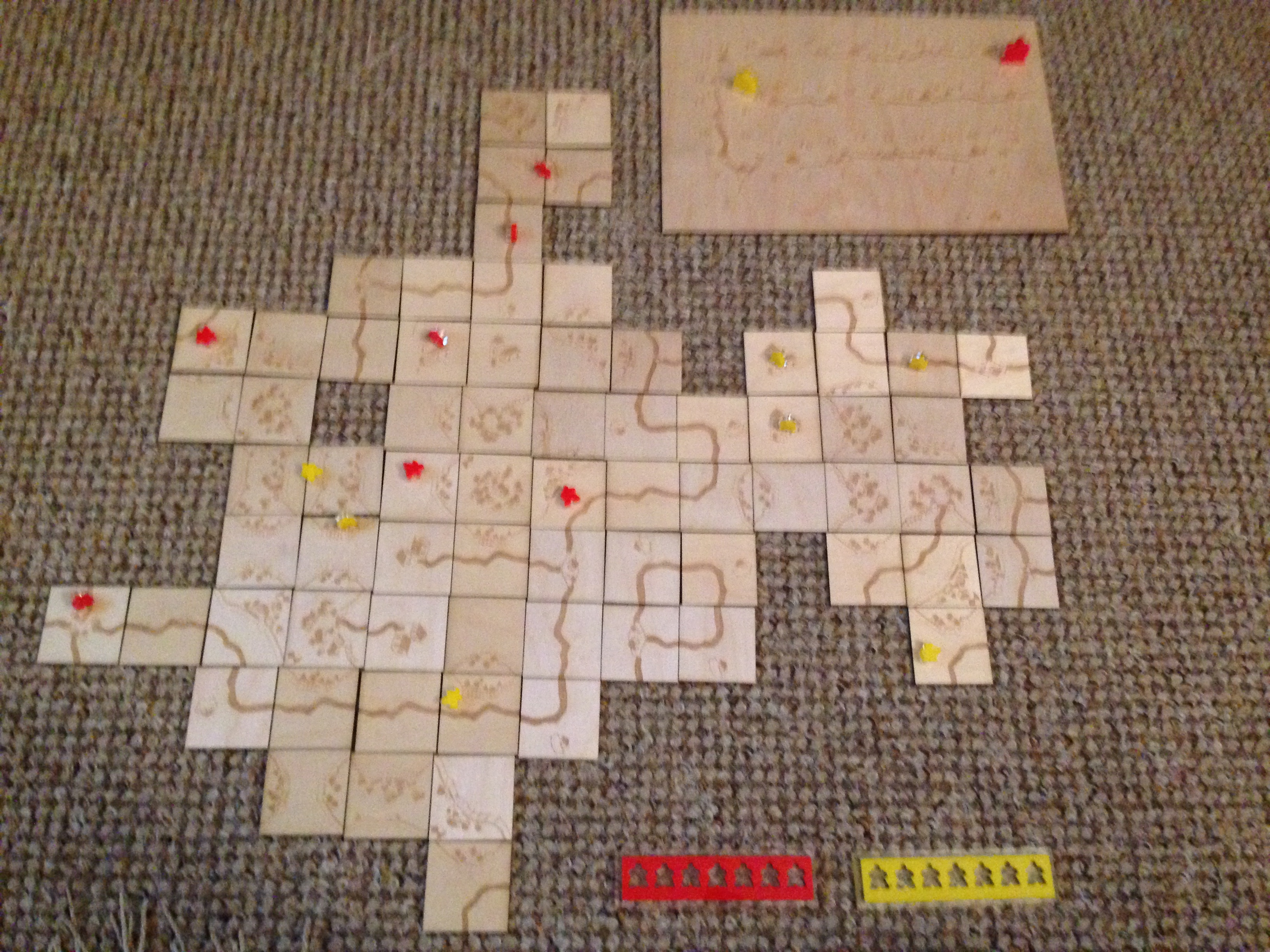 Wooden Carcassonne board game.