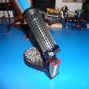 Soldering iron holder with fume extractor