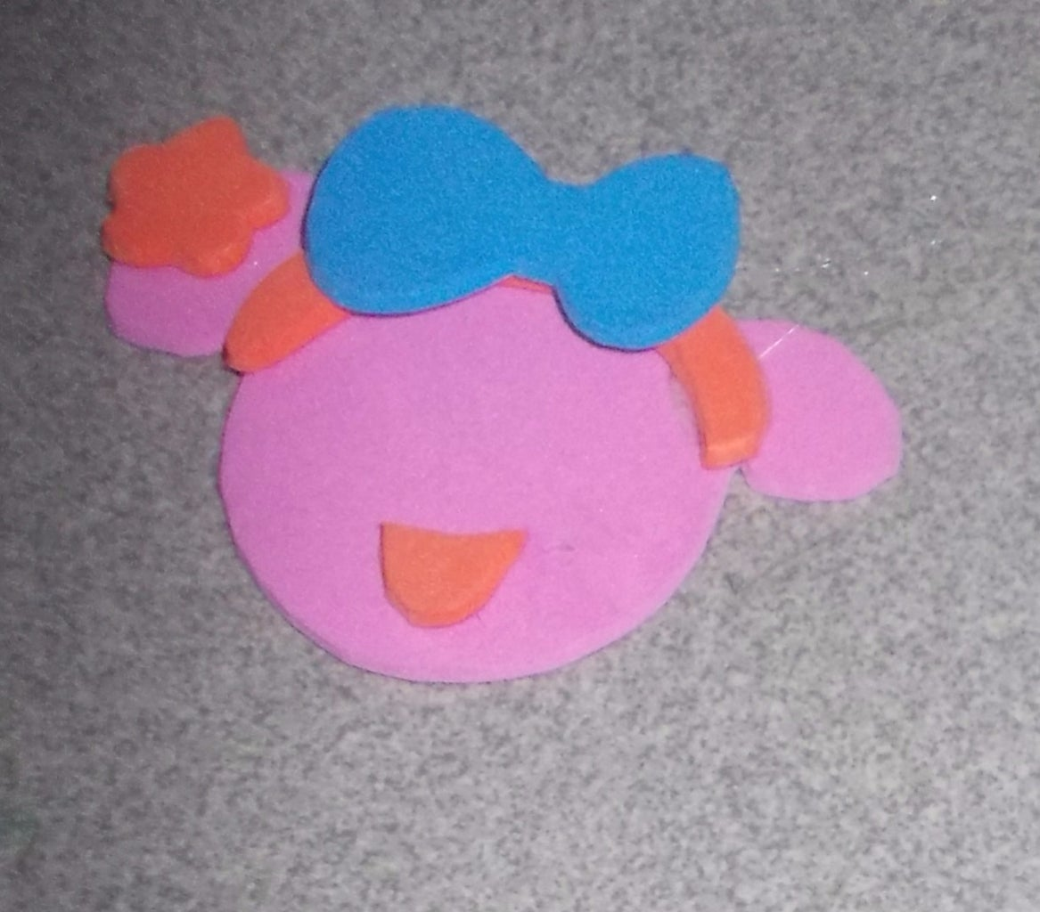 Cut the Blue Foam Bow. Glue the Bow Onto the Headband and the Flower Onto the Right Ear.