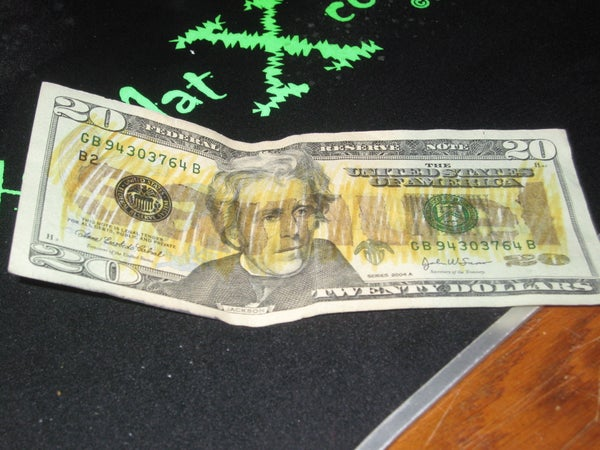 Hidden Message on US Bills That Only Counterfeit Money Detecting Markers Can Detect