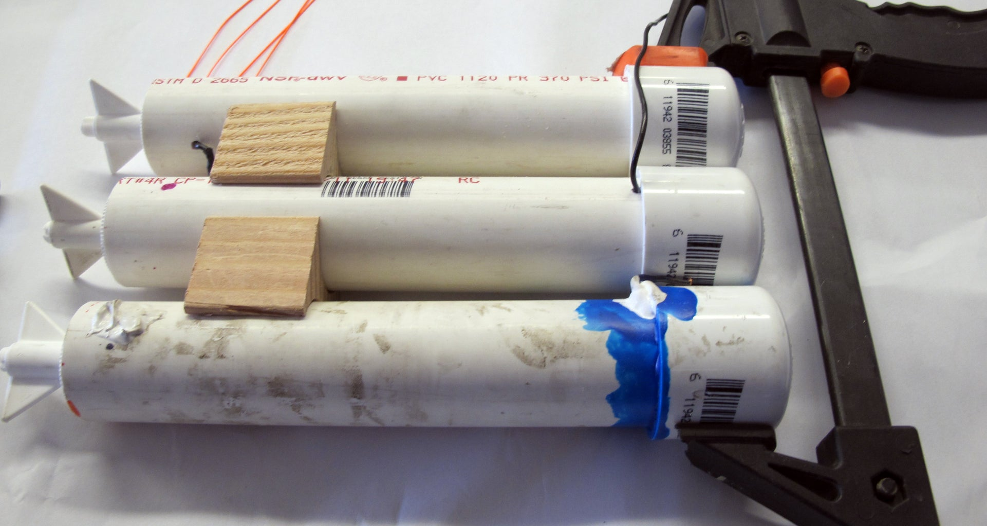 Cut a Piece of Wood As a Stabilizer for the Two Torpedo Like Battery Tubes