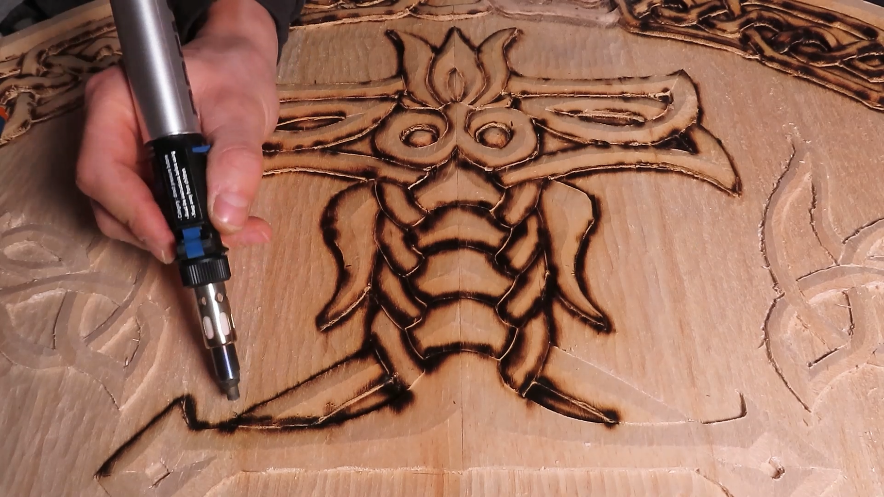 Burning the Wooden Carved Shapes.