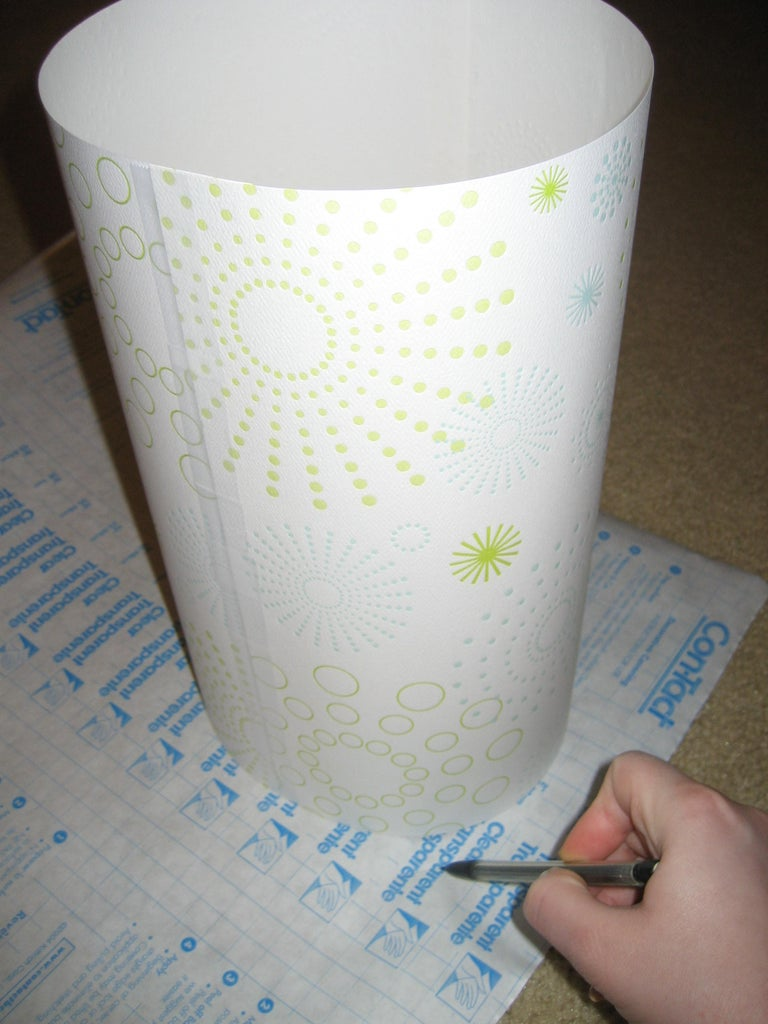 Place the Cylinder on Top of the Clear Contact Paper, and Draw a Circle Onto the Contact Paper That Is About an Inch Wider Than the Base of the Cylinder.