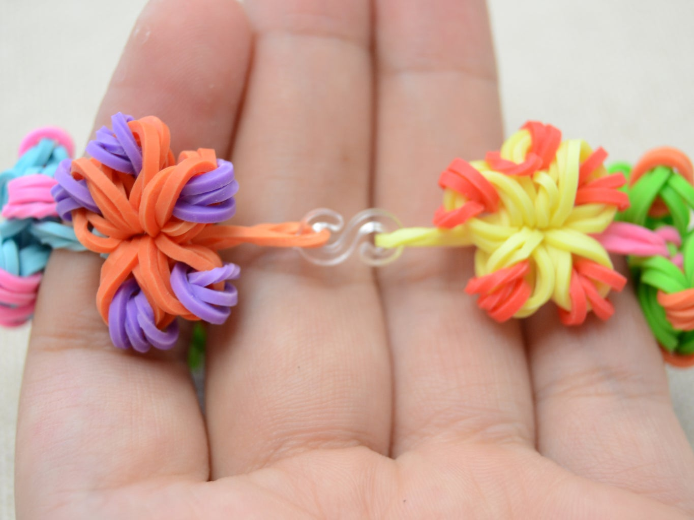 Follow to Connect All the Seven Flowers,  Then Use an S-clip to Attach Both Ends;