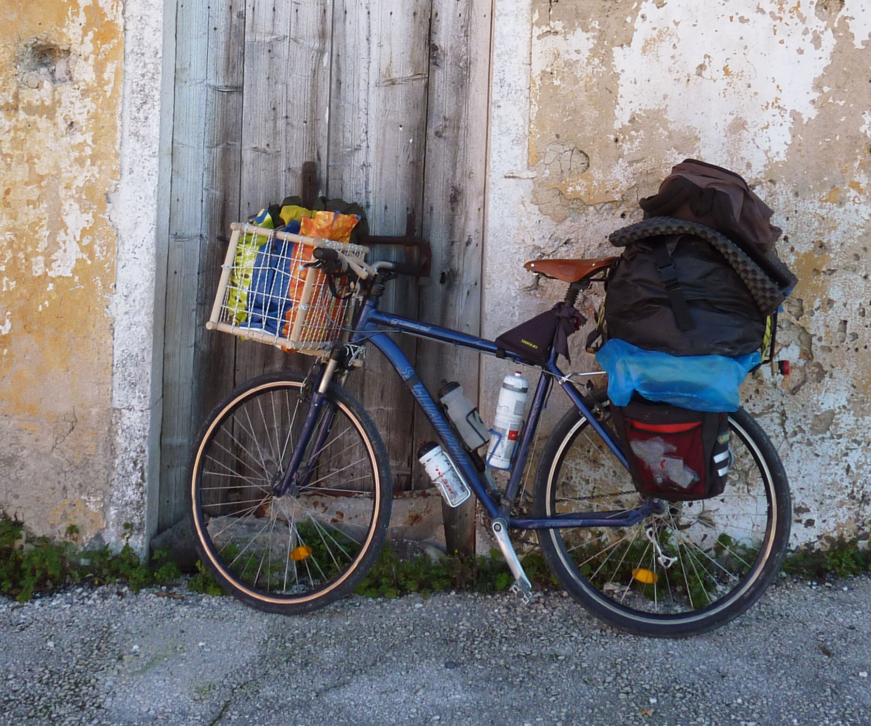 Heavy Duty bicycle basket from broomsticks and rope!