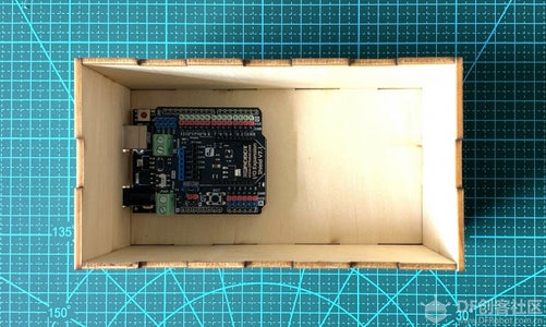 Plug the Gravity IO Expansion Shield to DFRduino UNO R3, Then Fix Them to the Bottom