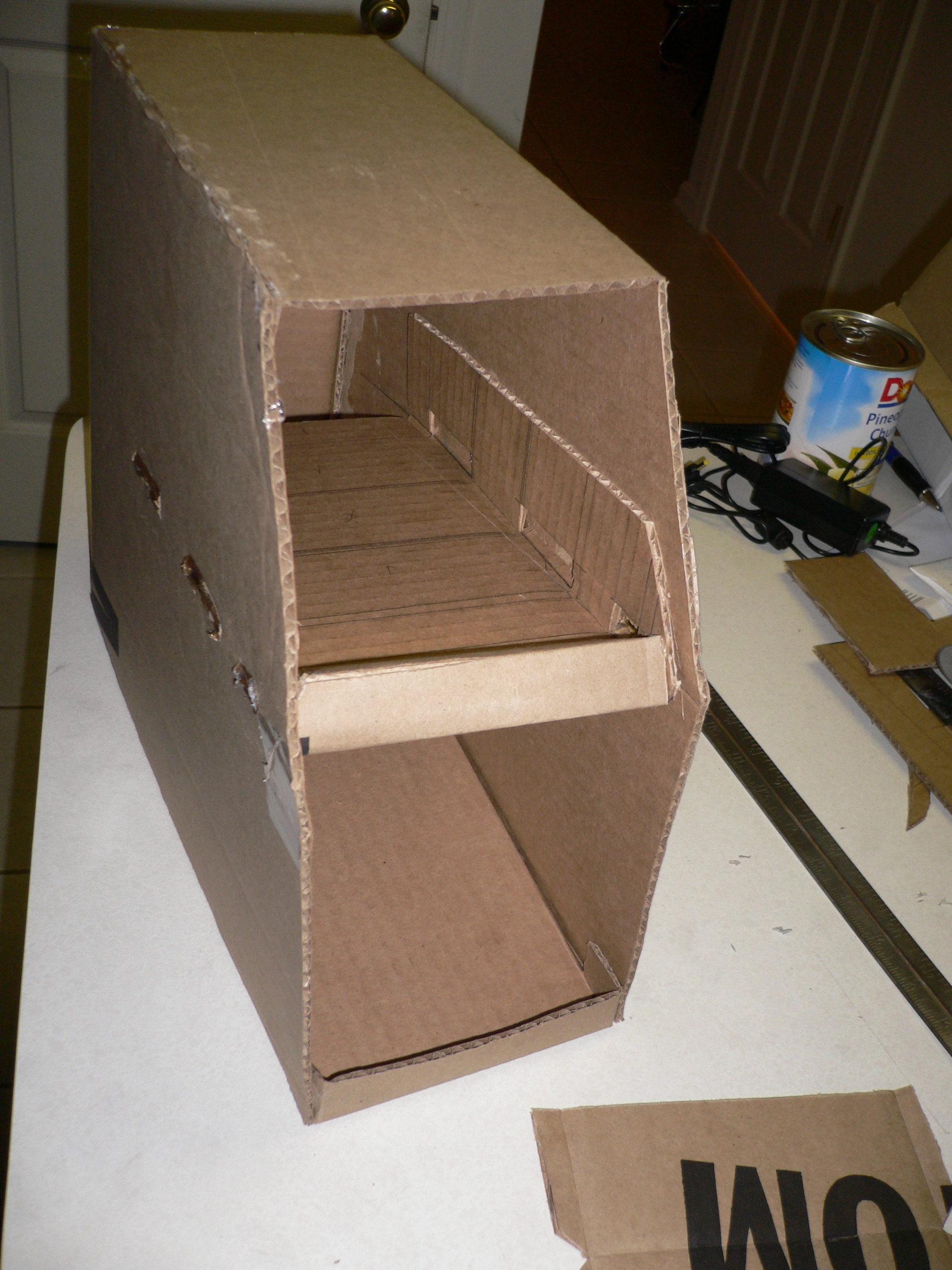 How to make a can organizer out of cardboard