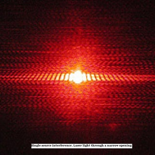 Single source interference. Laser light through a narrow opening.JPG