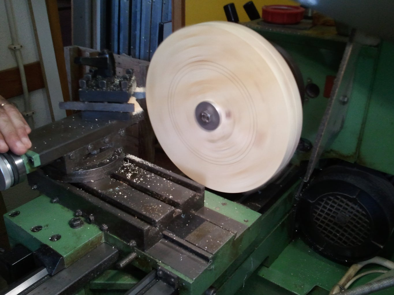 Trimming the Wooden Circles Using a Lathe Machine