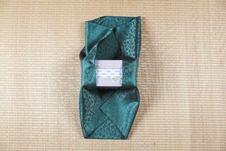 Fold the Left and Right Edges of the Bojagi Over the Tissue  Box.