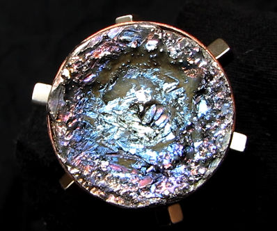 Eye-catcher piece with multiple spinning magnets and bismuth crystals