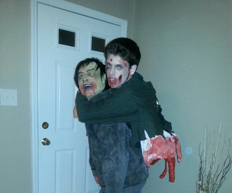 Zombie carryng a half zombie!