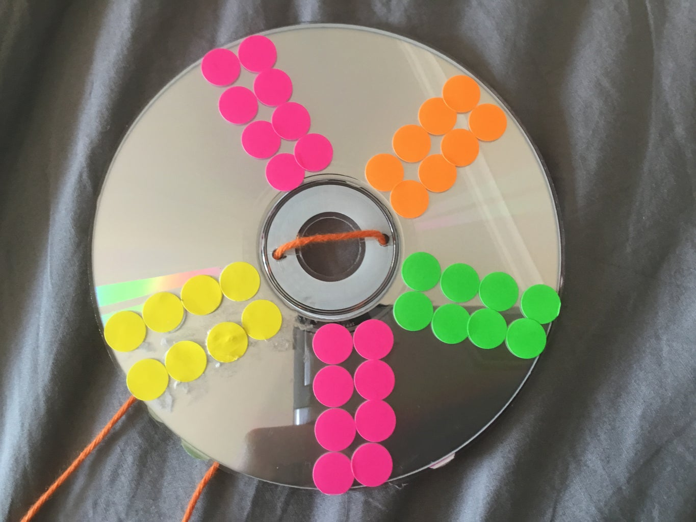 Attaching the String to the Cd.