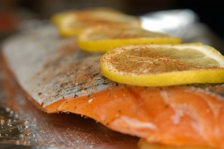 Sandwich the Salmon Between Lemon Layers.