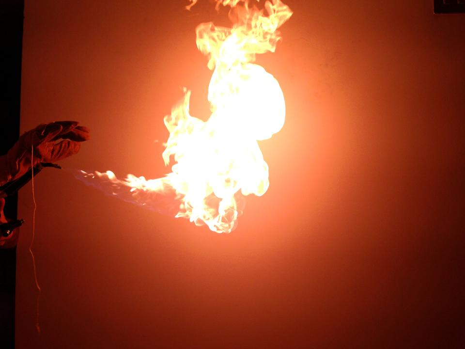 Easy but destructive wrist mounted flamethrower