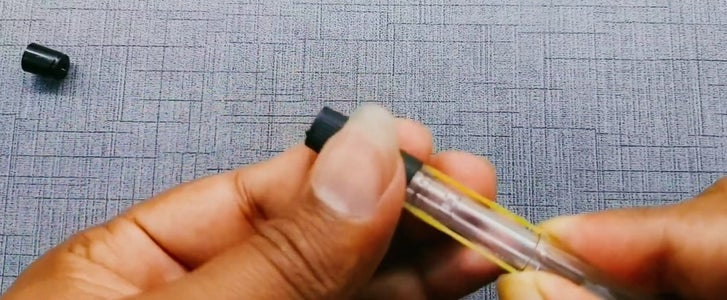 Take a Rubber Band and Place It Over Pen and Cover It With the Rubber Cover of Pen Which You Just Removed