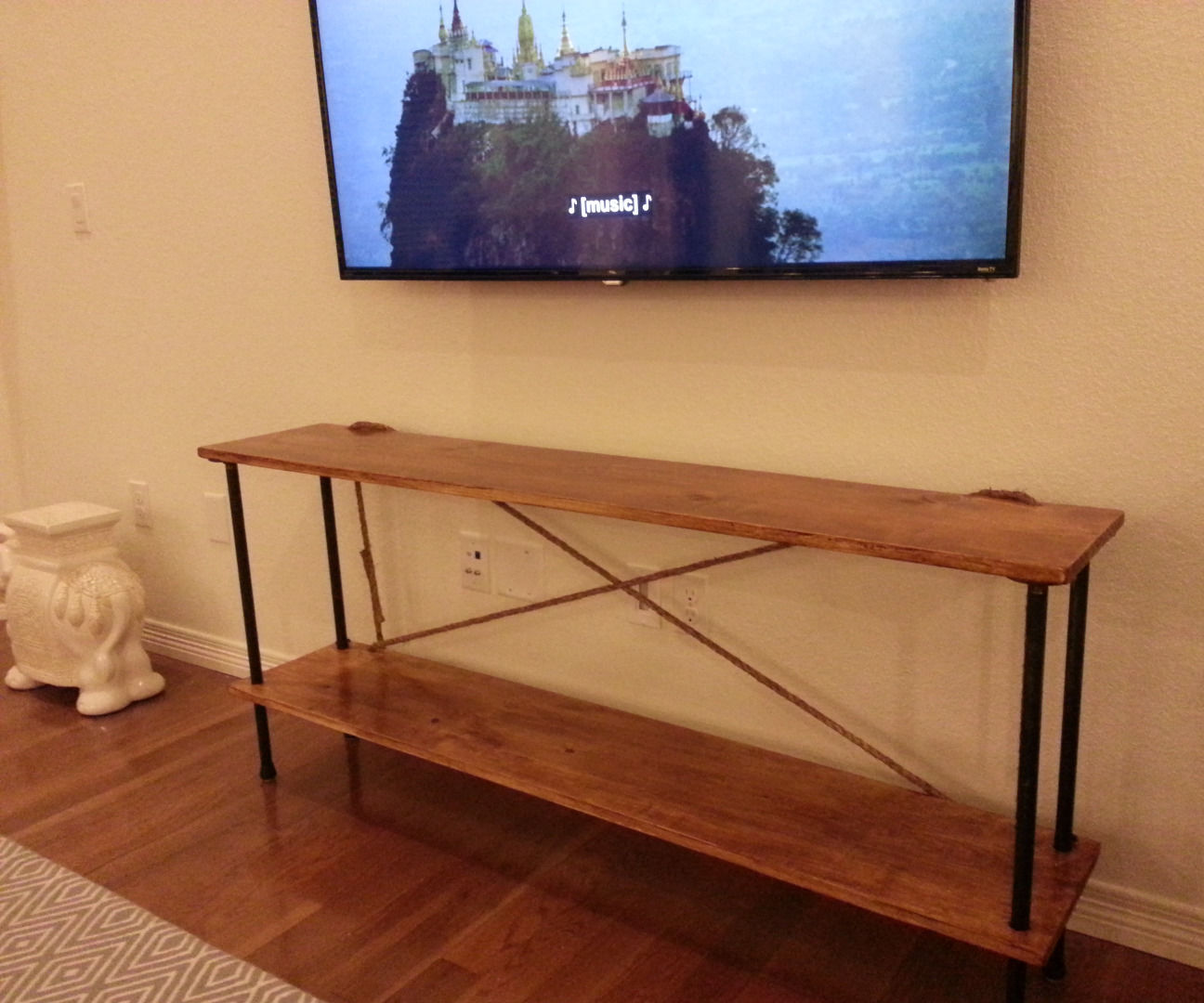 Industrial console table, rope/wood/steel, $100 in parts.