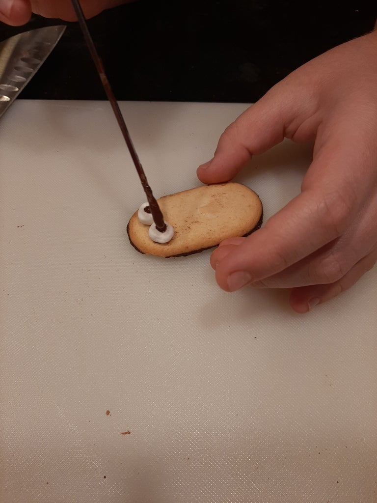 Put the Two Halves of the Marsh-mellow on the Dots to Make Eyes and Then Put Two More Dots  on the Marsh-mellows.