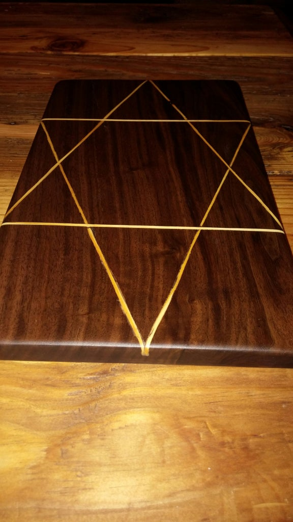 Cutting Board Out of Black Walnut and 2x4 Inlay