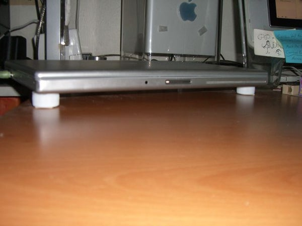 Laptop Stand From 4 Bottlecaps