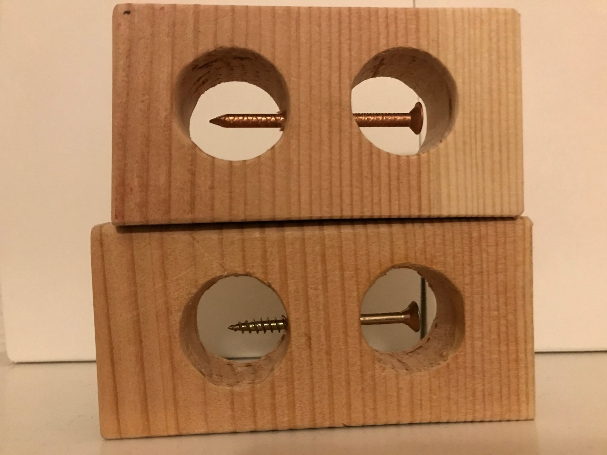 Impossible Nail in Wooden Block
