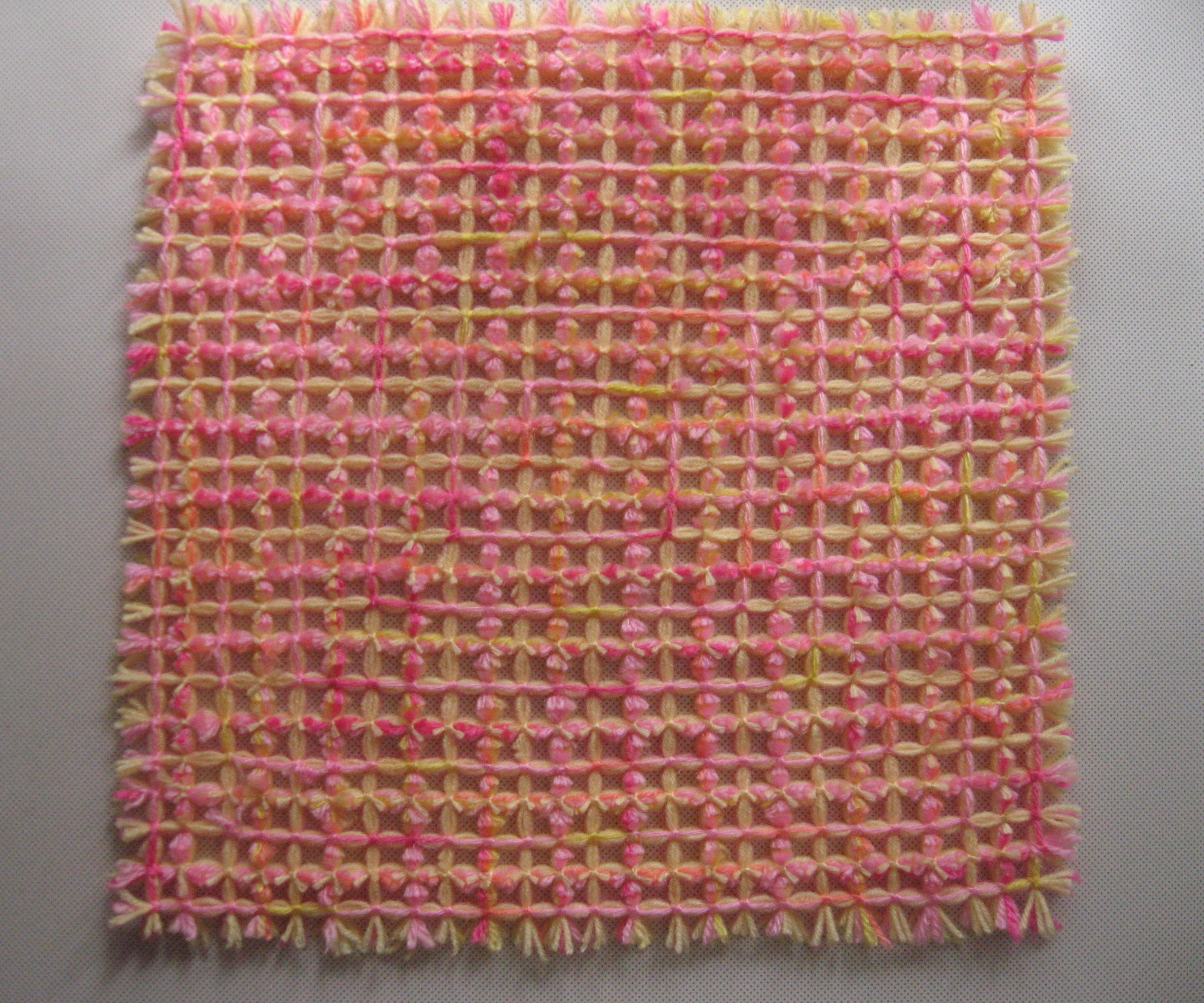 How to Weave a Mat With Small Pom Poms