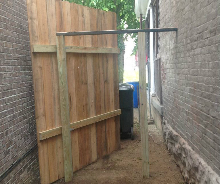 Secret door that looks like an 8' fence