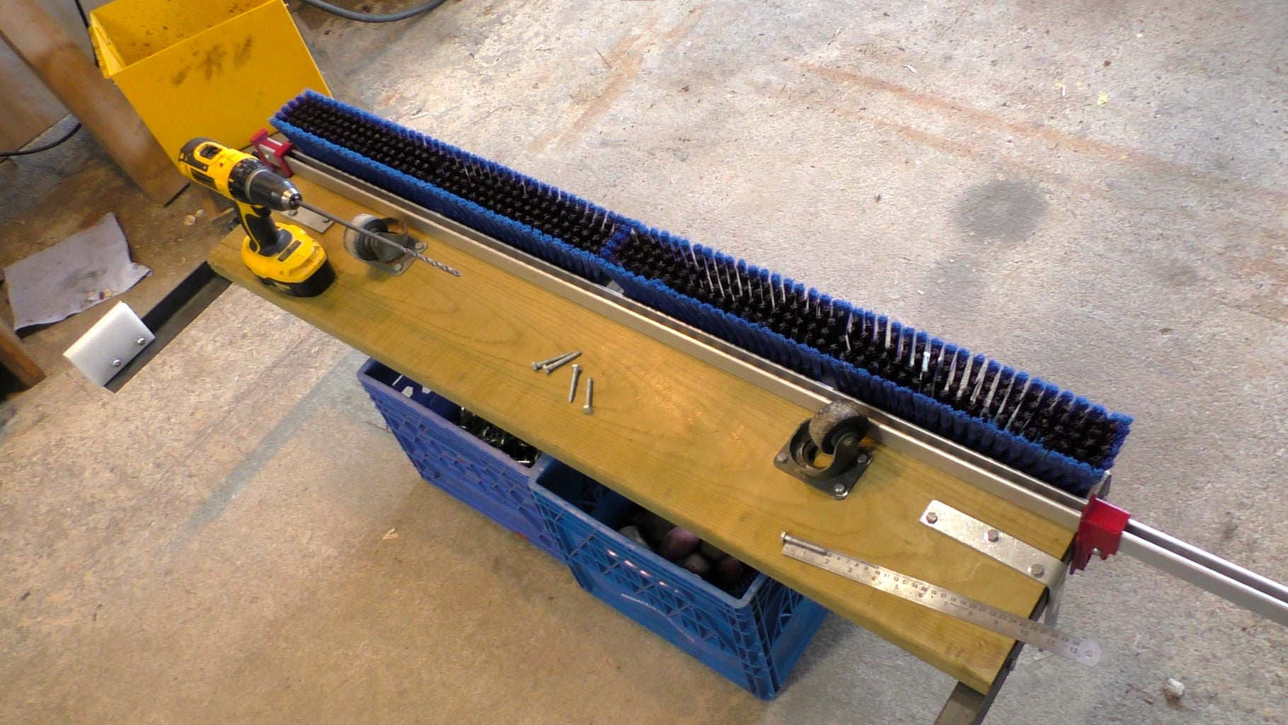 Installing Broom Release Arms, Magnets, New Brooms, Casters, and the Guide Brackets