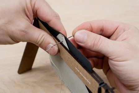 Saddle Stitching - Pulling the Thread Through