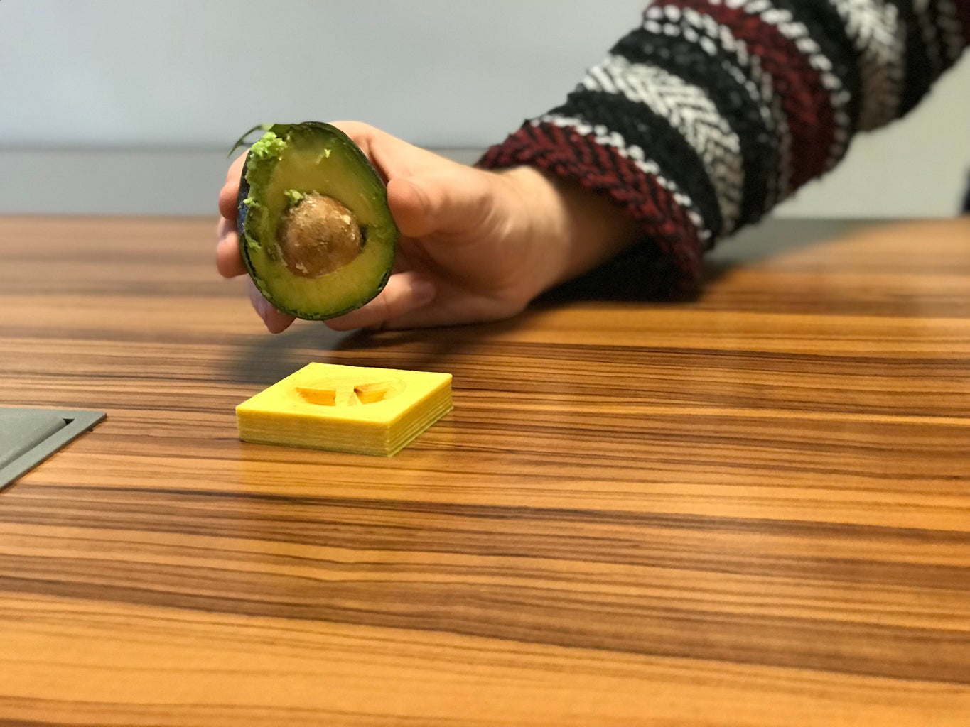 Place Avocado Onto Pitting Device and Twist Clockwise