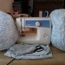 Old t-shirt & shredded paper= dog/floor pillow