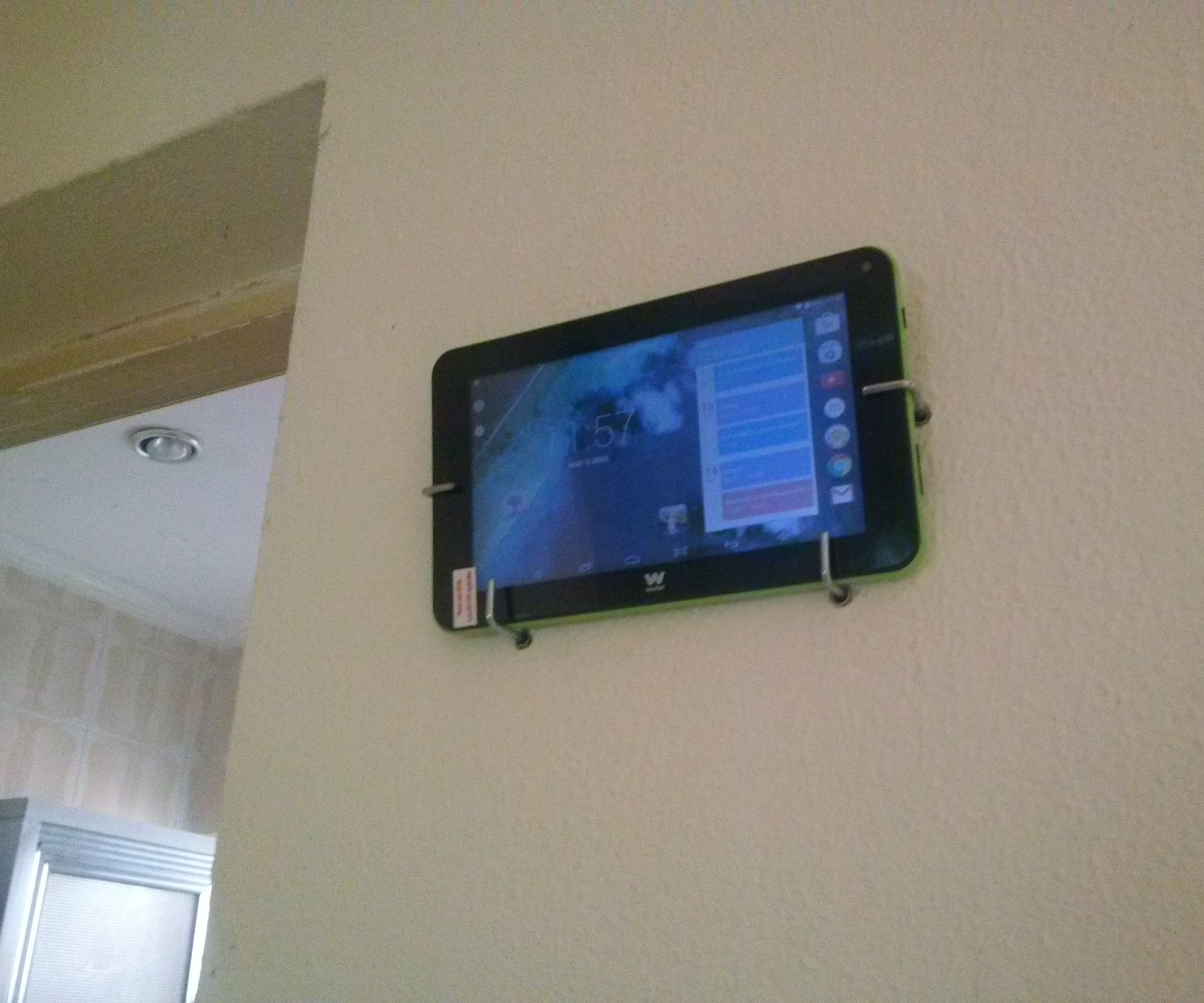 Easy tablet stand for the wall (drill, hooks and plastic anchors).