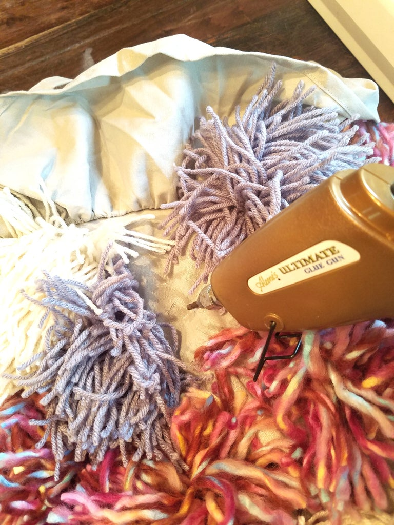 Begin to Glue the Pom Poms on the Bag