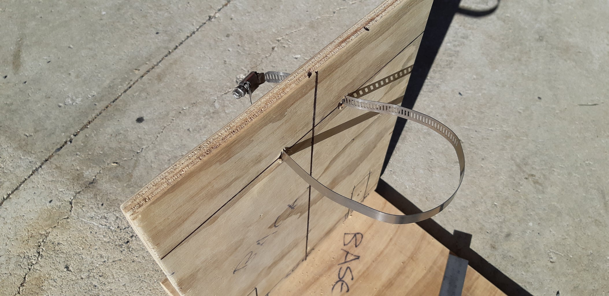 ATTACHING THE SODA BOTTLE TO THE BACK BOARD
